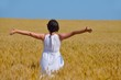 young woman in wheat field at summer