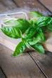 Fresh basil on wooden table