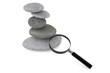 Zen garden stones and magnifying glass