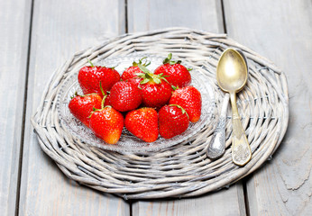 Strawberries on wicker grey tray