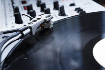 Turntable, vinyl and sound mixer