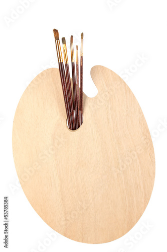 Wooden art palette with brushes for painting isolated on white