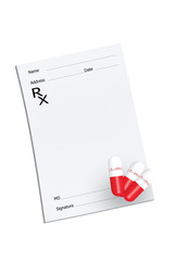 An empty prescription pad with vitamin pills