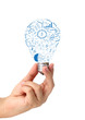 Creative light bulb in hand with drawing business strategy plan