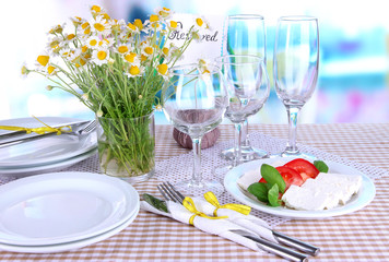 Table setting with chamomiles