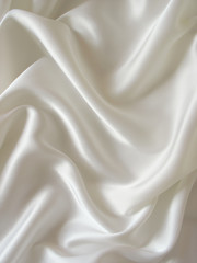 Draped white silk background