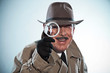 Vintage detective with mustache and hat. Looking through magnify