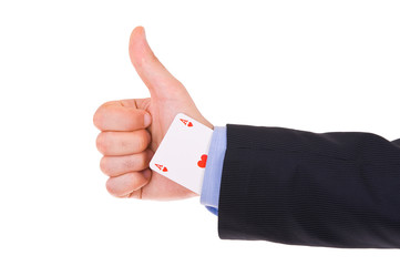 Business man showing ok sign with ace card under sleeve.