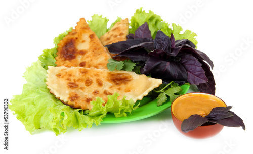 Tasty chebureks with fresh herbs on plate,isolated on white