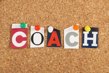The word Coach on a cork notice board