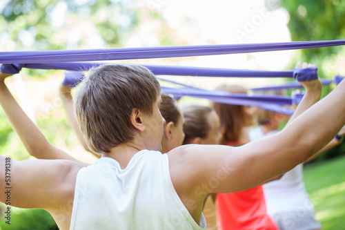 Young caucasians working out in a park
