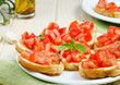 Italian bruschetta with tomato and basil on the plate