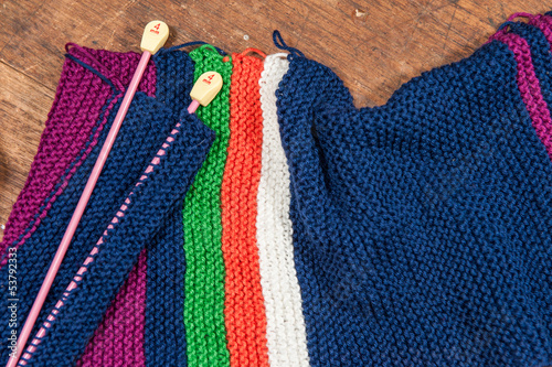 Knitting Needles and Woolen Scarf