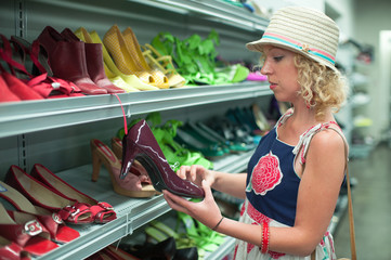 Shoe shopping in a thrift store