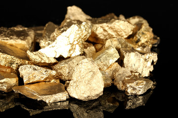 Golden nuggets isolated on black