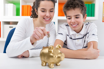 siblings with piggybank