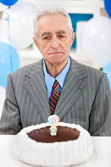 Senior man with birthday cake