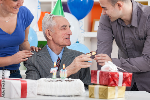 Senior man celebrating his birthday with family
