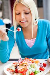 Beautiful young girl having lunch