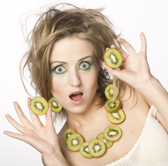 happy woman holding kiwi