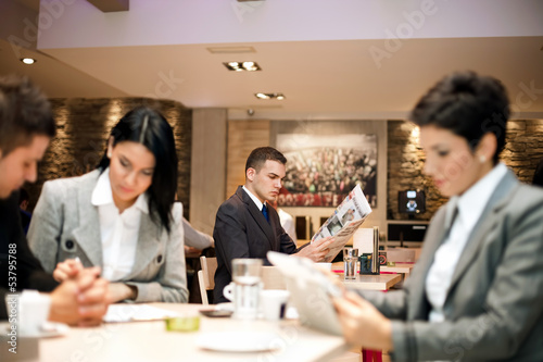 Business people in cafe