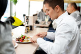 young couple enjoying lunch at a restaurant poster