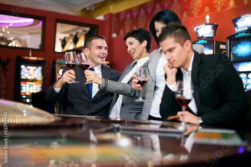 Two couple gambling in casino