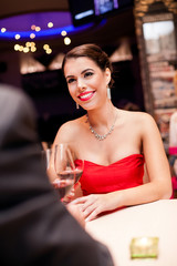 woman in red dress in restaurant