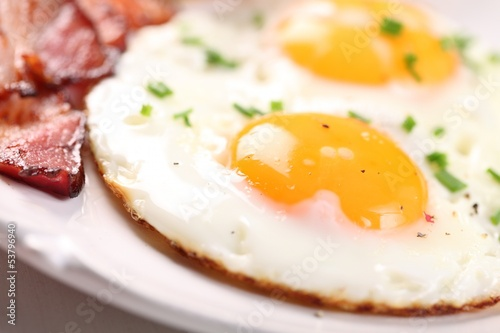 Close-up of fried egg and bacon on plate