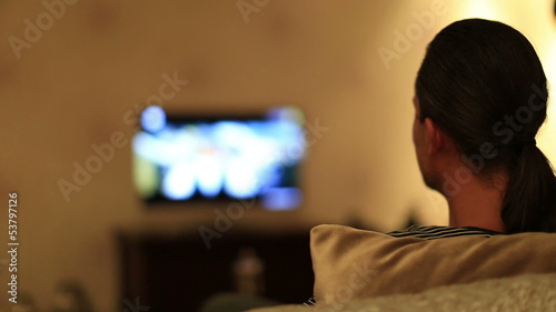 man watching television at home