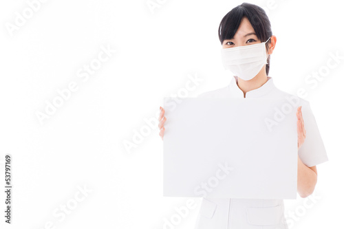 attractive asian nurse with mask on white background