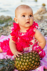 Little baby girl reasting on the beach