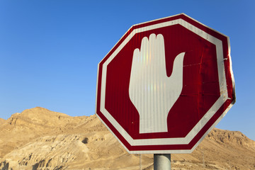Damaged Stop Sign in the Desert