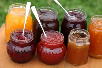 Glass with jam and spoons