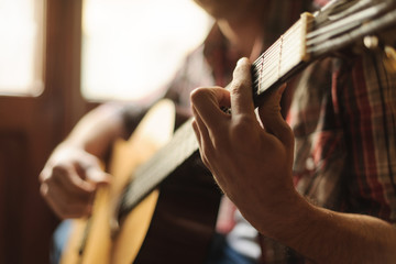 Creativity in focus. Close-up of men playing acoustic guitar