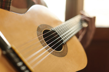 Close-up on the guitar. Close up of men playing acoustic guitar