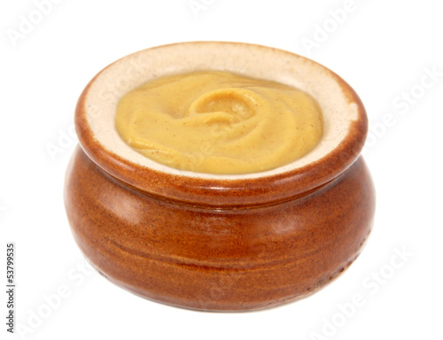 Dijon mustard served in a small ceramic pot