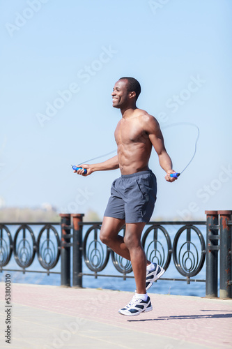 Man jumping on the jumping rope. Young african decsent men with