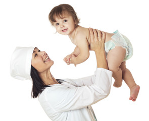 Doctor holding baby over his head.