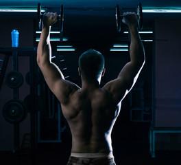 Workout of bodybuilder at gym