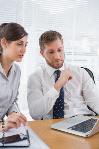 Businessman meeting with a colleague using laptop