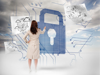 Businesswoman selecting a giant padlock