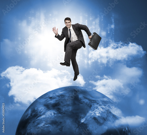 Businessman jumping over a planet