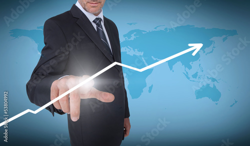 Businessman selecting an arrow pointing up