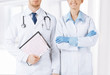 nurse and male doctor holding cardiogram