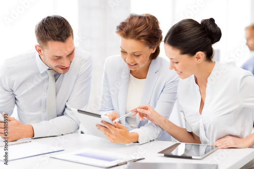 business team working with tablet pcs in office