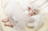 Baby with christening clothes