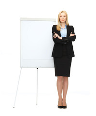 businesswoman with flipchart in office