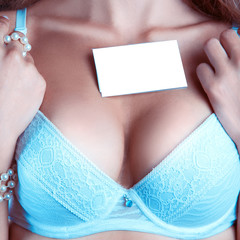 woman's breast in a bra with empty name tag
