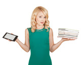 the beautiful, slender blonde compares a tablet and books